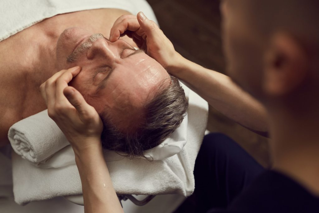 Mature Man Enjoying Facial Massage in SPA